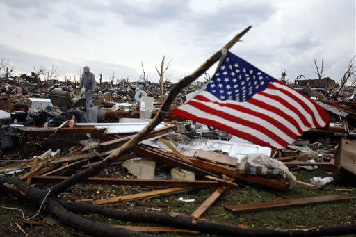 "<div class=""meta ""><span class=""caption-text "">Josh Ramsey looks through the rubble of what is left of his mother-in-law's home following a tornado Monday, May 23, 2011, in Joplin , Mo.  A massive tornado that tore a six-mile path across southwestern Missouri killed at least 89 people as it smashed the city of Joplin, ripping into a hospital, crushing cars like soda cans and leaving behind only splintered tree trunks where entire neighborhoods once stood. (AP Photo/Jeff Roberson) (AP Photo/ Jeff Roberson)</span></div>"