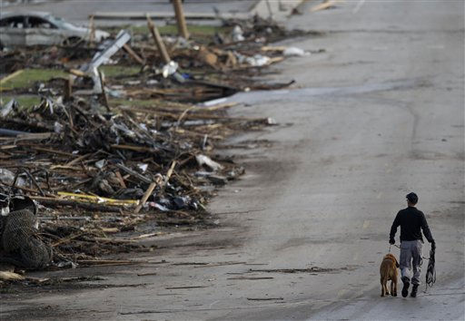 A rescue worker walks past debris at Joplin High School, which was severely damaged by a tornado in Joplin, Mo., Monday, May 23, 2011. A large tornado moved through much of the city Sunday, damaging a hospital and hundreds of homes and businesses and killing at least 89 people. &#40;AP Photo&#47;Charlie Riedel&#41; <span class=meta>(AP Photo&#47; Charlie Riedel)</span>