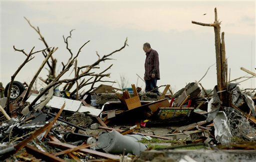 A man sorts through tornado debris in Joplin, Mo., Monday, May 23, 2011. A large tornado moved through much of the city Sunday, damaging a hospital and hundreds of homes and businesses and killing at least 116 people. &#40;AP Photo&#47;Charlie Riedel&#41; <span class=meta>(AP Photo&#47; Charlie Riedel)</span>