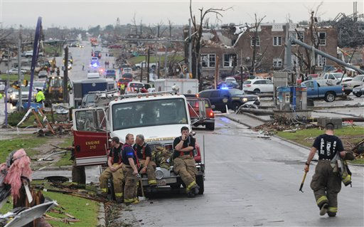 Nevada Missouri firefighters take a break from search and rescue work in Joplin, Mo, on Monday, May 23, 2011. Fire and rescue workers from neighboring cities and states have joined the rescue effort from the tornado that struck Joplin on Sunday, May 22. &#40;AP Photo&#47;Mike Gullett&#41; <span class=meta>(AP Photo&#47; Mike Gullett)</span>