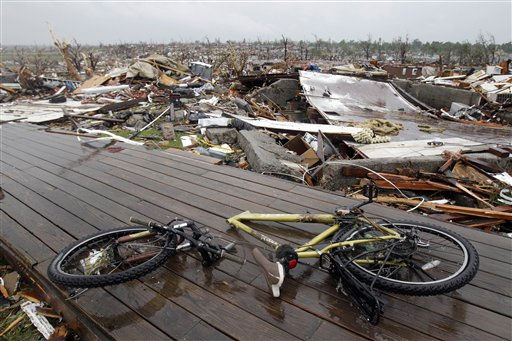 "<div class=""meta ""><span class=""caption-text "">A broken bike and what remains of a destroyed neighborhood are seen Monday, May 23, 2011, in Joplin, Mo. A large tornado moved through much of the city Sunday, damaging a hospital and hundreds of homes and businesses. (AP Photo/Jeff Roberson) (AP Photo/ Jeff Roberson)</span></div>"
