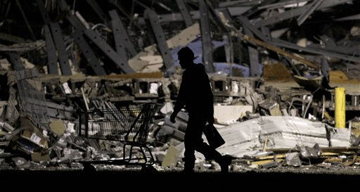 "<div class=""meta ""><span class=""caption-text "">An emergency worker searches a Walmart store that was severely damaged by a tornado in Joplin, Mo., Monday, May 22, 2011. A large tornado moved through much of the city Sunday, damaging a hospital and hundreds of homes and businesses. (AP Photo/Charlie Riedel) (AP Photo/ Charlie Riedel)</span></div>"