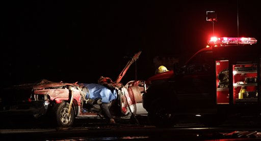 ** CORRECTS DATE TO May 23 **A body is seen in a tornado ravaged car while emergency workers wait for a medical team to arrive in Joplin, Mo., Monday, May 23, 2011. A large tornado moved through much of the city Sunday, damaging a hospital and hundreds of homes and businesses. &#40;AP Photo&#47;Charlie Riedel&#41; <span class=meta>(AP Photo&#47; Charlie Riedel)</span>