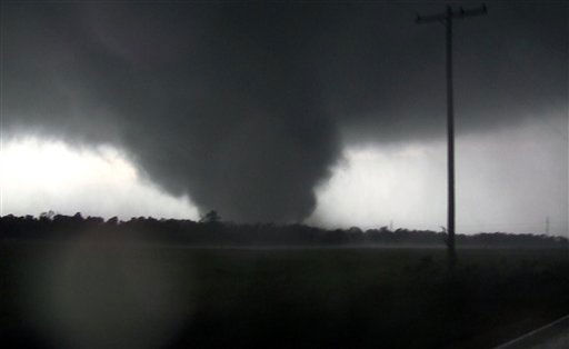 "<div class=""meta ""><span class=""caption-text "">This frame grab from video shows a massive tornado on Sunday, May 22, 2011, outside Joplin, Mo.  The tornado tore a 6-mile path across southwestern Missouri killing at least 89 people as it slammed into the city of Joplin, ripping into a hospital, crushing cars like soda cans and leaving a forest of splintered tree trunks behind where entire neighborhoods once stood.  (AP Photo/tornadovideo.net) (AP Photo/ SS JHC**NY**)</span></div>"