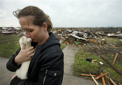 Ashley Stephens holds a ferret she rescued from the home of a missing woman while helping a friend collect belongings Monday, May 23, 2011, in Joplin, Mo. A large tornado moved through much of the city Sunday, damaging a hospital and hundreds of homes and businesses and killing at least 89 people. &#40;AP Photo&#47;Charlie Riedel&#41; <span class=meta>(AP Photo&#47; Charlie Riedel)</span>