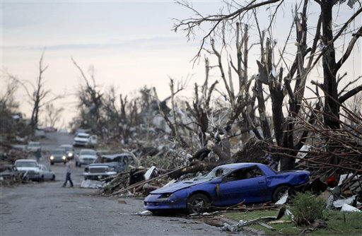 Tornado damage is seen Monday, May 23, 2011, in Joplin, Mo. A large tornado moved through much of the city Sunday, damaging a hospital and hundreds of homes and businesses and killing at least 89 people. &#40;AP Photo&#47;Jeff Roberson&#41; <span class=meta>(AP Photo&#47; Jeff Roberson)</span>