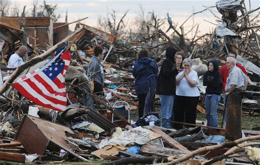 "<div class=""meta ""><span class=""caption-text "">Mary Womack, in white top at the right, reacts to the news that the renter that lived in her house had been found and taken to the hospital on Monday, May 23, 2011. There were at least 89 deaths and numerous casualties from the tornado that struck Joplin, Mo. on Sunday. (AP Photo/Mike Gullett) (AP Photo/ Mike Gullett)</span></div>"