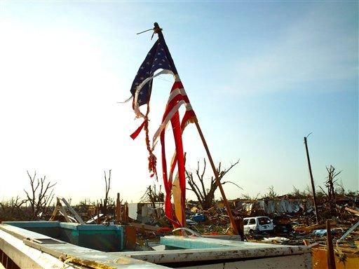"<div class=""meta image-caption""><div class=""origin-logo origin-image ""><span></span></div><span class=""caption-text"">A torn American flag stands in the wreckage of a church in Joplin, Mo., Tuesday, May 24, 2011. Rescue crews worked through the rain-soaked chill of night, ignoring lightning and strong winds to dig through splintered homes, crumpled businesses and crushed cars in Joplin. (AP Photo/Robert Ray) (AP Photo/ Robert Ray)</span></div>"