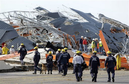 "<div class=""meta ""><span class=""caption-text "">Members of Missouri Task Force One search-and-rescue team work at a tornado-damaged Home Depot store Tuesday, May 24, 2011, in Joplin , Mo. A large tornado moved through much of the city Sunday, damaging a hospital and hundreds of homes and businesses. (AP Photo/Jeff Roberson) (AP Photo/ Jeff Roberson)</span></div>"