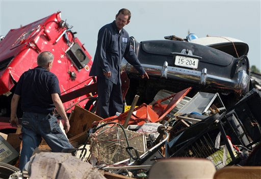 Gary Terry, left, and James Ruddick look through the debris of the auto repair shop they work at in Joplin, Mo., Tuesday, May 24, 2011. At least 116 people were killed and hundreds more injured when a tornado cut a destructive path through Joplin on Sunday evening. &#40;AP Photo&#47;Mark Schiefelbein&#41; <span class=meta>(AP Photo&#47; Mark Schiefelbein)</span>