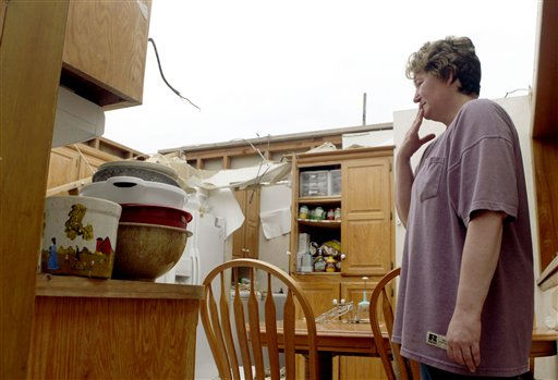 "<div class=""meta ""><span class=""caption-text "">Amy Gilbert stands in what is left of her kitchen Tuesday, May 24, 2011, in Joplin , Mo. Gilbert and her husband, Eric, were standing in the kitchen as the roof began to tear away from the house during a tornado Sunday night.  The couple was able to seek shelter in a bathroom off the kitchen along with their eight-year-old daughter their dogs and a friend.  All survived without injury.   (AP Photo/Jeff Roberson) (AP Photo/ Jeff Roberson)</span></div>"