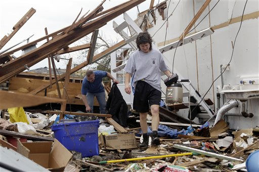 Carla Austin, right, picks through the rubble of her home with the help of friend Jon Derouchey Tuesday, May 24, 2011, in Joplin , Mo. A large tornado moved through much of the city Sunday, damaging a hospital and hundreds of homes and businesses. &#40;AP Photo&#47;Jeff Roberson&#41; <span class=meta>(AP Photo&#47; Jeff Roberson)</span>