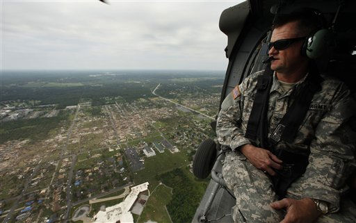 Missouri National Guard Col. Randy Alewel surveys the path of a powerful tornado through Joplin, Mo. Tuesday, May 24, 2011. A tornado moved through much of the city Sunday, damaging a hospital and hundreds of homes and businesses and killing at least 116 people. &#40;AP Photo&#47;Charlie Riedel&#41; <span class=meta>(AP Photo&#47; Charlie Riedel)</span>