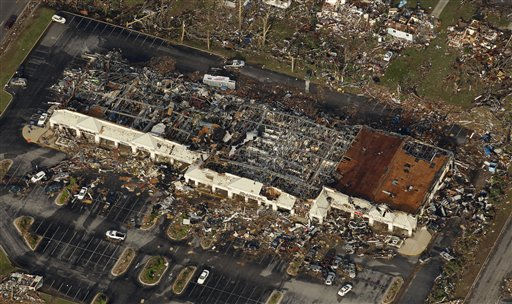 A destroyed shopping center is seen in Joplin, Mo. Tuesday, May 24, 2011. A tornado moved through much of the city Sunday, damaging a hospital and hundreds of homes and businesses and killing at least 116 people. &#40;AP Photo&#47;Charlie Riedel&#41; <span class=meta>(AP Photo&#47; Charlie Riedel)</span>