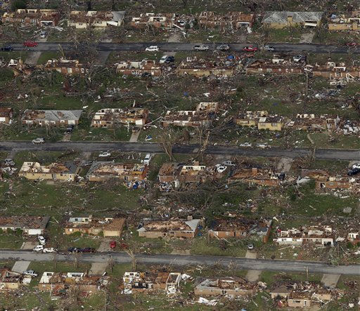 "<div class=""meta ""><span class=""caption-text "">A destroyed neighborhood is seen in Joplin, Mo. Tuesday, May 24, 2011. A tornado moved through much of the city Sunday, damaging a hospital and hundreds of homes and businesses and killing at least 116 people. (AP Photo/Charlie Riedel) (AP Photo/ Charlie Riedel)</span></div>"