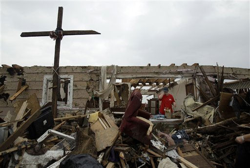 "<div class=""meta ""><span class=""caption-text "">Michelle Haselwood pauses as she picks through the rubble of her mother's home Tuesday, May 24, 2011, in Joplin , Mo. A large tornado moved through much of the city Sunday, damaging a hospital and hundreds of homes and businesses. (AP Photo/Jeff Roberson) (AP Photo/ Jeff Roberson)</span></div>"