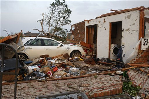 "<div class=""meta ""><span class=""caption-text "">A car sits in what used to be the garage of a brick home in Piedmont, Okla., following a tornado, Tuesday, May 24, 2011. Several tornadoes struck Oklahoma City and its suburbs during rush hour, killing at least four people and injuring at least 60 others, including three children who were in critical condition, authorities said. (AP Photo/Sue Ogrocki) (AP Photo/ Sue Ogrocki)</span></div>"