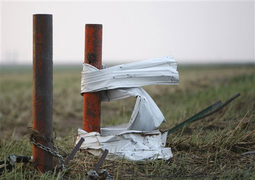 Metal is twisted around a pole in Piedmont, Okla., following a tornado Tuesday, May 24, 2011. Several tornadoes struck Oklahoma City and its suburbs during rush hour, killing at least four people and injuring at least 60 others, including three children who were in critical condition, authorities said. &#40;AP Photo&#47;Sue Ogrocki&#41; <span class=meta>(AP Photo&#47; Sue Ogrocki)</span>