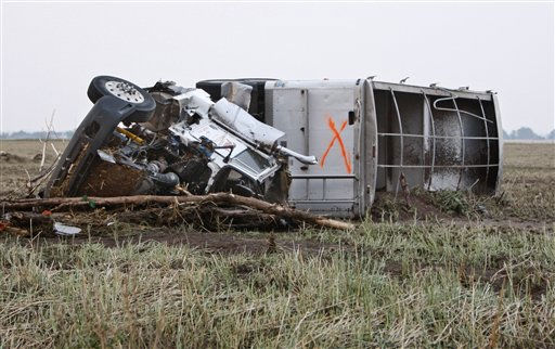 A truck marked with an &#34;x&#34;, lies on its side in a field following a tornado in Piedmont, Okla., Tuesday, May 24, 2011. The &#34;x&#34; is usually an indication that a vehicle has been checked for survivors. &#40;AP Photo&#47;Sue Ogrocki&#41; <span class=meta>(AP Photo&#47; Sue Ogrocki)</span>