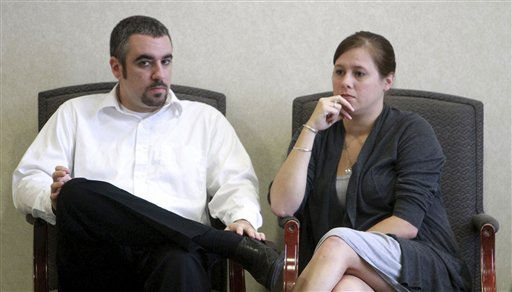 Lee Anthony, brother of Casey Anthony, left, and his fiance, Mallory Parker are shown before she testifies during day 4 of the trial at the Orange County Courthouse, in Orlando, Fla., Friday, May 27, 2011. Anthony has pleaded not guilty to first-degree murder of her daughter, 2-year-old Caylee Anthony in the summer of 2008. If convicted, she could be sentenced to death. &#40;AP Photo&#47;Joe Burbank, Pool&#41; <span class=meta>(AP Photo&#47; Joe Burbank)</span>