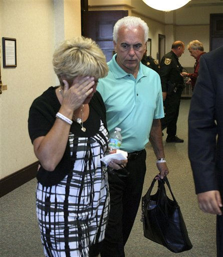 "<div class=""meta ""><span class=""caption-text "">Cindy Anthony, left, is consoled by her husband George Anthony following her testimony, outside the courtroom during day six of the murder trial of Casey Anthony at the Orange County Courthouse in Orlando, Fla., Tuesday, May 31, 2011.      (AP Photo/Joe Burbank, Pool) (AP Photo/ Joe Burbank)</span></div>"