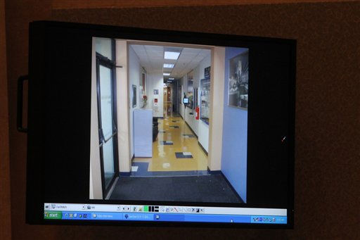 A courtroom monitor shows a photo entered into evidence during the Casey Anthony trial at the Orange County Courthouse on Thursday, June 2, 2011, in Orlando, Fla. The photo shows a hallway in a building at Universal Studios Orlando where Anthony claimed she worked. She did not have a job at Universal at that time.   Anthony, 25, is charged with murder in the 2008 death of her daughter Caylee.  If convicted, she could be sentenced to death.   &#40;AP Photo&#47;Red Huber,Pool&#41; <span class=meta>(AP Photo&#47; Red Huber)</span>