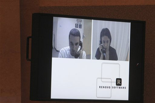 "<div class=""meta image-caption""><div class=""origin-logo origin-image ""><span></span></div><span class=""caption-text"">A video entered into evidence is seen on  a monitor as Lee Anthony, left, talks with his sister Casey, right, while Casey was in jail following the disappearance of her daughter. The video was shown at Casey's first degree murder trial at the Orange County Courthouse on Thursday, June 2, 2011, in Orlando, Fla. Casey Anthony, 25, is charged with murder in the 2008 death of her daughter Caylee.  If convicted, she could be sentenced to death.  (AP Photo/Red Huber, Pool) (AP Photo/ Red Huber)</span></div>"