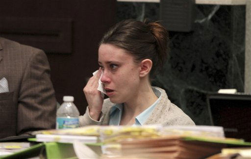 "<div class=""meta image-caption""><div class=""origin-logo origin-image ""><span></span></div><span class=""caption-text"">Casey Anthony cries while watching a video of herself talking with her brother Lee Anthony shortly after she was in jail in 2008. The video was presented as evidence in her murder trial at the Orange County Courthouse on Thursday, June 2, 2011, in Orlando, Fla. Anthony, 25, is charged with murder in the 2008 death of her daughter Caylee.  If convicted, she could be sentenced to death.  (AP Photo/Red Huber, Pool) (AP Photo/ Red Huber)</span></div>"