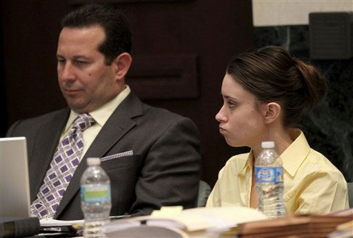 "<div class=""meta image-caption""><div class=""origin-logo origin-image ""><span></span></div><span class=""caption-text"">Casey Anthony, right, and her attorney Jose Baez listen as video tapes are played in court during her trial at the Orange County Courthouse, Friday,  June 3, 2011 in Orlando. The tapes document jail-house conversations between her and her parents after she had been detained following the disappearance of her daughter Caylee. Anthony, 25, is charged with killing her daughter Caylee in the summer of 2008. (AP Photo/Red Huber, Pool) (AP Photo/ Red Huber)</span></div>"