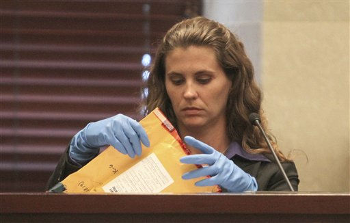 Christine Markiewicz of the Orange County Sheriffs Office looks at evidence during the Casey Anthony trial at the Orange County Courthouse, Friday, June 3, 2011 in Orlando. Markiewicz testified about evidence she gathered including toothbrushes and thermometers identified as belonging to Caylee Anthony, Casey&#39;s daughter that she is accused of killing in the summer of 2008. &#40;AP Photo&#47;Red Huber, Pool&#41; <span class=meta>(AP Photo&#47; Red Huber)</span>