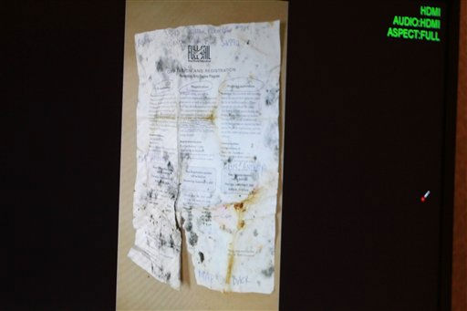 A photo entered into evidence is seen on a courtroom monitor during the Casey Anthony trial at the Orange County Courthouse on Tuesday, June 7, 2011, in Orlando, Fla.  The photo shows paperwork from Full Sail University that was found in a bag of trash that was found in the trunk of Anthony&#39;s car. Anthony is charged with killing her 2-year old daughter in 2008. &#40;AP Photo&#47;Joe Burbank,Pool&#41; <span class=meta>(AP Photo&#47; Joe Burbank)</span>