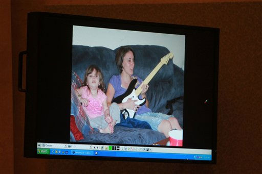 A photo showing Casey Anthony and her daughter Caylee Anthony that was entered into evidence is seen projected on a courtroom monitor during the Casey Anthony trial at the Orange County Courthouse, Wednesday, June 8, 2011 in Orlando, Fla. The photo was found on a computer during the investigation. Anthony is charged with killing Caylee in the summer of 2008. &#40;AP Photo&#47;Joe Burbank, Pool&#41; <span class=meta>(AP Photo&#47; Joe Burbank)</span>