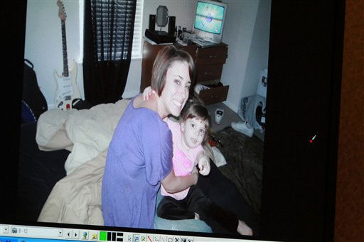 "<div class=""meta image-caption""><div class=""origin-logo origin-image ""><span></span></div><span class=""caption-text"">A photo showing Casey Anthony and her daughter Caylee Anthony that was entered into evidence is seen projected on a courtroom monitor during the Casey Anthony trial at the Orange County Courthouse, Wednesday, June 8, 2011 in Orlando, Fla. The photo was found on a computer during the investigation. Anthony is charged with killing Caylee in the summer of 2008. (AP Photo/Joe Burbank, Pool) (AP Photo/ Joe Burbank)</span></div>"