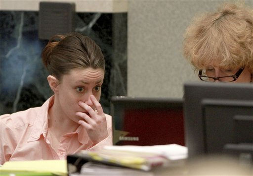 "<div class=""meta image-caption""><div class=""origin-logo origin-image ""><span></span></div><span class=""caption-text"">Casey Anthony, left, talks with her attorney Dorothy Clay Sims during a break in her murder trial at the Orange County Courthouse, Wednesday, June 8, 2011 in Orlando, Fla. Anthony, 25, is charged with killing her daughter Caylee in the summer of 2008. (AP Photo/Joe Burbank, Pool) (AP Photo/ Joe Burbank)</span></div>"