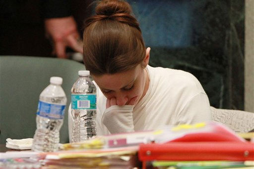 Casey Anthony becomes upset during a break in her murder trial at the Orange County Courthouse on Thursday, June 9, 2011, in Orlando, Fla.  Anthony had been seeing forensic evidence photos of the scene where her daughter Caylee&#39;s  remains were found. Court was ended early because Casey Anthony was too sick to continue. Anthony is charged with killing her 2-year old daughter in 2008.&#40;AP Photo&#47;Joe Burbank,Pool&#41; <span class=meta>(AP Photo&#47; Joe Burbank)</span>