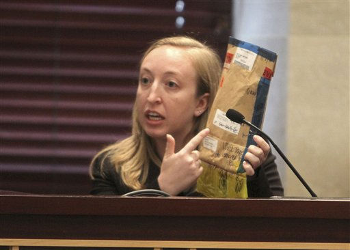 Elizabeth Fontaine, a latent print expert for the FBI, testifies during the trial of Casey Anthony at the Orange County Courthouse on Monday, June 13, 2011, in Orlando, Fla. She is holding an evidence envelope that contains duct tape found at the crime scene. Anthony, 25,  is charged with killing her 2-year old daughter in 2008.&#40;AP Photo&#47;Red Huber,Pool&#41; <span class=meta>(AP Photo&#47; Red Huber)</span>