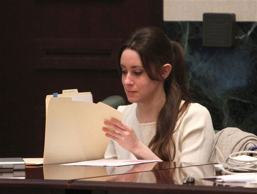 "<div class=""meta ""><span class=""caption-text "">Casey Anthony looks at documents before the start of her murder trial at the Orange County Courthouse, in Orlando, Fla., Tuesday, June 14, 2011.  Anthony, 25,  is charged with killing her 2-year old daughter in 2008.(AP Photo/Red Huber,Pool) (AP Photo/ Red Huber)</span></div>"