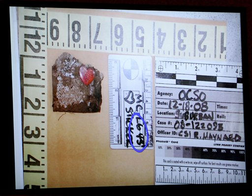 A photograph, showing a heart shaped sticker on a piece of cardboard and the location where it was found near the remains of Caylee Anthony, is projected on a large monitor in the courtroom, after being entered into evidence and shown to the jury during the murder trial of Casey Anthony at the Orange County Courthouse, in Orlando, Fla., Thursday, June 16, 2011.  Anthony, 25,  is charged with killing her 2-year old daughter in 2008. &#40;AP Photo&#47;Red Huber, Pool&#41; <span class=meta>(AP Photo&#47; Red Huber)</span>