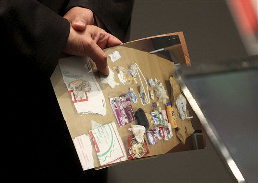 An evidence photo showing trash found in the trunk of a car is held by an attorney during the Casey Anthony murder trial at the Orange County Courthouse, Friday, June 17, 2011 in Orlando, Fla. Anthony, 25, is charged with killing her daughter Caylee in the summer of 2008. &#40;AP Photo&#47;Red Huber, Pool&#41; <span class=meta>(AP Photo&#47; Red Huber)</span>