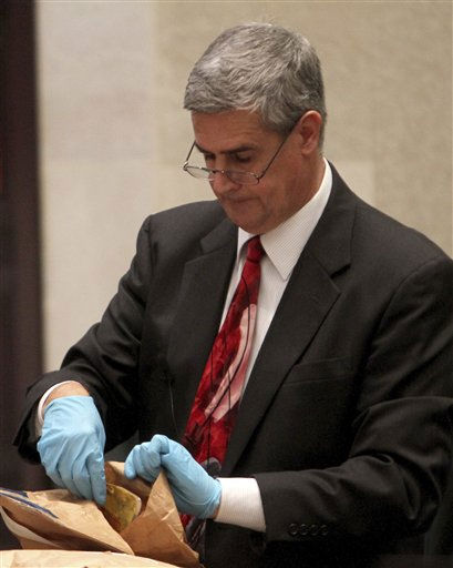 Assistant State Attorney Jeff Ashton handles evidence during the cross examination of entomologist Dr. Tim Huntington at Casey Anthony&#39;s murder trial at the Orange County Courthouse, Friday, June 17, 2011 in Orlando, Fla. Anthony, 25, is charged with killing her daughter Caylee in the summer of 2008. &#40;AP Photo&#47;Red Huber, Pool&#41; <span class=meta>(AP Photo&#47; Red Huber)</span>