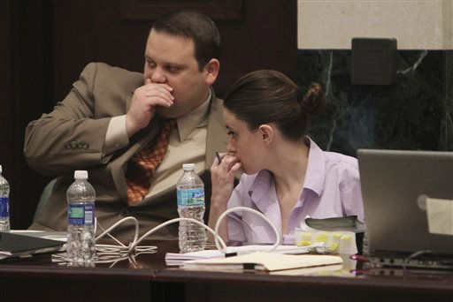 "<div class=""meta image-caption""><div class=""origin-logo origin-image ""><span></span></div><span class=""caption-text"">Attorney Will Slabaugh, left, talks with Casey Anthony during her murder trial at the Orange County Courthouse, Friday, June 17, 2011 in Orlando, Fla. Anthony, 25, is charged with killing her daughter Caylee in the summer of 2008. (AP Photo/Red Huber, Pool) (AP Photo/ Red Huber)</span></div>"