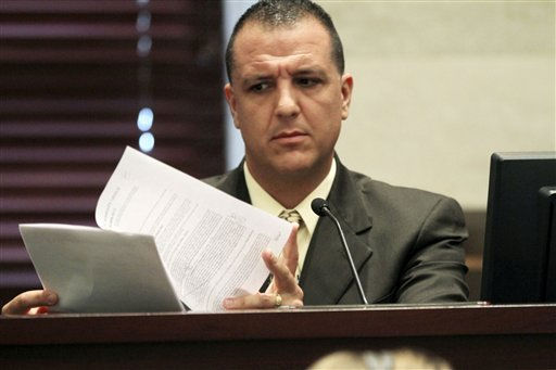 "<div class=""meta image-caption""><div class=""origin-logo origin-image ""><span></span></div><span class=""caption-text"">Orange County Sheriff's Department homicide detective, Yuri Melich, testifies during the Casey Anthony Muder trial at the Orange County Courthouse in Orlando, Fla., Tuesday, June 21, 2011. Casey Anthony, 25, is charged with killing her daughter Caylee in the summer of 2008. (AP Photo/Red Huber, Pool) (AP Photo/ Red Huber)</span></div>"