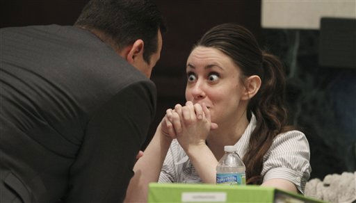 "<div class=""meta image-caption""><div class=""origin-logo origin-image ""><span></span></div><span class=""caption-text"">Casey Anthony talks with her attorney Jose Baez during a recess in her murder trial at the Orange County Courthouse in Orlando, Fla., Wednesday, June 22, 2011. Anthony, 25,  is charged with killing her daughter, Caylee in the summer of 2008.   (AP Photo/Red Huber, Pool) (AP Photo/ Red Huber)</span></div>"