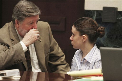 "<div class=""meta ""><span class=""caption-text "">Defense attorney Cheney Mason, left,  talks with his client Casey Anthony before the start of court in her murder trial at the Orange County Courthouse in Orlando, Fla. on Friday, June 24, 2011.  Anthony, 25, is charged with the murder of her 2-year old daughter in 2008.(AP Photo/Red Huber,Pool) (AP Photo/ Red Huber)</span></div>"