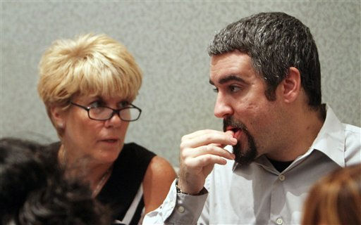 "<div class=""meta ""><span class=""caption-text "">Casey Anthony's mother Cindy Anthony talks with her son Lee Anthony continuation of Casey's murder trial at the Orange County Courthouse Thursday, June 30, 2011 in Orlando, Fla. Casey Anthony, 25, has plead not guilty in the death of her daughter, Caylee, and could face the death penalty if convicted of that charge. (AP Photo/Red Huber, Pool) (AP Photo/ Red Huber)</span></div>"