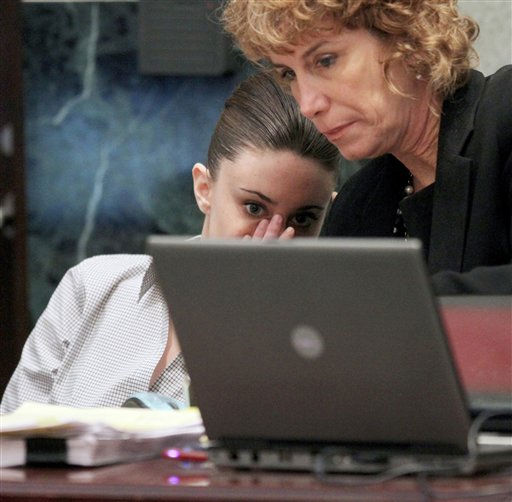 "<div class=""meta image-caption""><div class=""origin-logo origin-image ""><span></span></div><span class=""caption-text"">Casey Anthony, left,  talks with her attorney Dorothy Clay Sims during Casey's murder trial at the Orange County Courthouse Thursday, June 30, 2011 in Orlando, Fla. Casey Anthony, 25, has plead not guilty in the death of her daughter, Caylee, and could face the death penalty if convicted of that charge. (AP Photo/Red Huber, Pool) (AP Photo/ Red Huber)</span></div>"