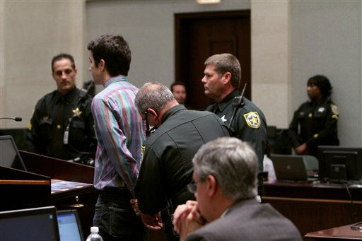 Spectator Matthew Bartlett is taken away by sheriff&#39;s deputies on a contempt charge for his obscene gesture toward assistant state attorney Jeff Ashton, seated foreground, during Casey Anthony&#39;s murder trial at the Orange County Courthouse Thursday, June 30, 2011 in Orlando, Fla. Casey Anthony, 25, has plead not guilty in the death of her daughter, Caylee, and could face the death penalty if convicted of that charge. &#40;AP Photo&#47;Red Huber, Pool&#41; <span class=meta>(AP Photo&#47; Red Huber)</span>