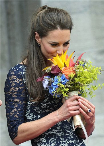 Kate the Duchess of Cambridge, smells her flowers as she takes part in a ceremony at Rideau Hall in Ottawa, Ontario on Thursday, June 30, 2011. &#40;AP Photo&#47;The Canadian Press, Nathan Denette&#41; <span class=meta>(AP Photo&#47; Nathan Denette)</span>