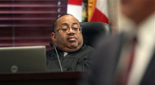 "<div class=""meta ""><span class=""caption-text "">Judge Belvin Perry listens during the state's closing arguments in the Casey Anthony murder trial in Orlando, Fla., Sunday, July 3, 2011. Anthony has plead not guilty to first-degree murder in the death of her daughter, Caylee, and could face the death penalty if convicted of that charge. (AP Photo/Red Huber, Pool) (AP Photo/ Red Huber)</span></div>"