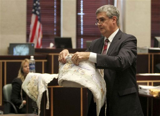 "<div class=""meta ""><span class=""caption-text "">Assistant state attorney Jeff Ashton shows bedding that match a blanket found with the remains of Caylee Anthony, during closing arguments in the Casey Anthony murder trial in Orlando, Fla., Sunday, July 3, 2011. Casey Anthony has plead not guilty to first-degree murder in the death of her daughter, Caylee, and could face the death penalty if convicted of that charge. (AP Photo/Red Huber, Pool) (AP Photo/ Red Huber)</span></div>"